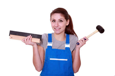 open minded: female worker holding hammer Stock Photo