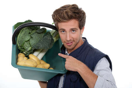 comestible: portrait of a gardener with vegetables