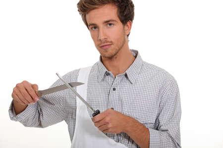 sharpening: Male chef sharpening knife