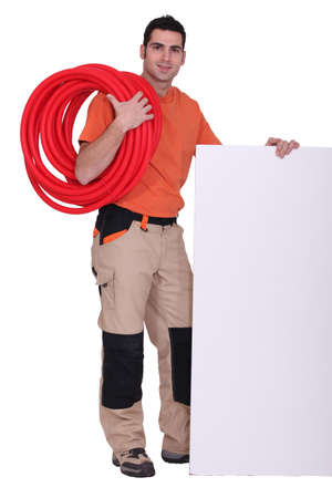 cabling: Handyman with cabling around his shoulder Stock Photo