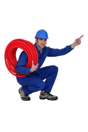 calzado de seguridad: Construcción Eyacular trabajador señalando con el dedo