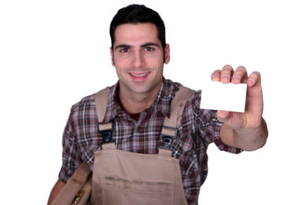Carpenter holding blank business card photo