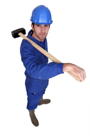 Man carrying sledge hammer Stock Photo - 16112367