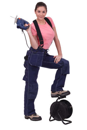 Tradeswoman holding up a jigsaw photo