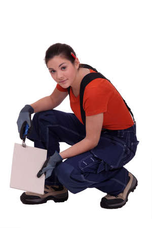 handywoman holding a tile photo