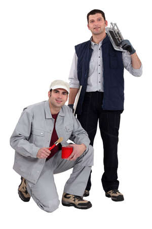 A team of tradesmen posing with their tools photo