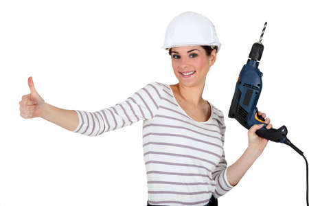 convinced: Tradeswoman giving the thumbs up Stock Photo