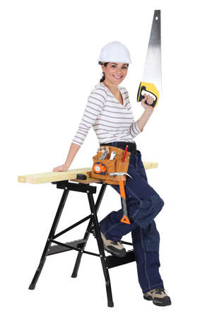 servicewoman: Female carpenter with a saw Stock Photo