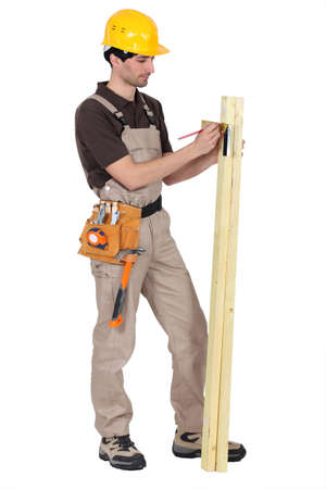 Tradesman using a try square to measure an angle Stock Photo - 16112943