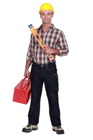 craftman: Craftman with spirit-level Stock Photo