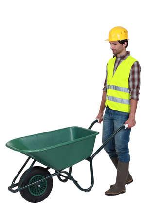 constructing: bricklayer and wheelbarrow