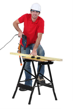 clamps: Tradesman using a power tool