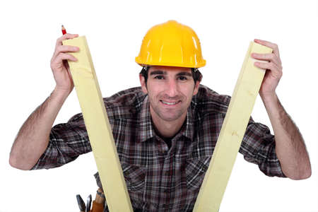 specialization: Man between two planks of wood Stock Photo