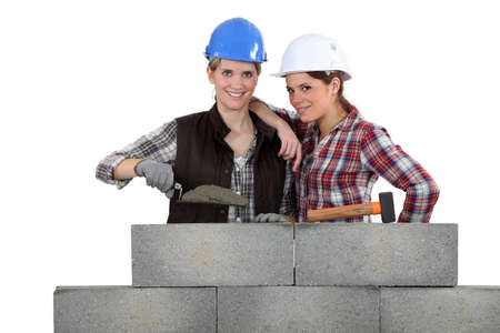 tapper: Female bricklayers Stock Photo
