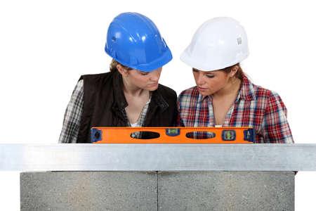 tradeswomen: Tradeswomen examining a blueprint together