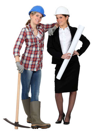 checkered skirt: Blue collar worker standing next to an engineer