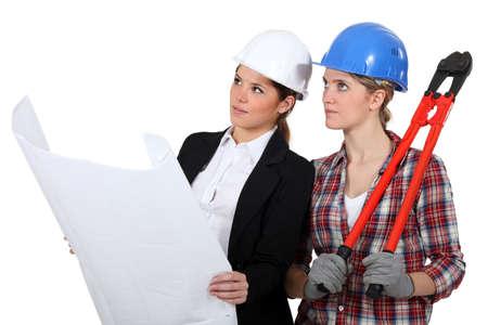 woman architect and woman mason Stock Photo - 16119619