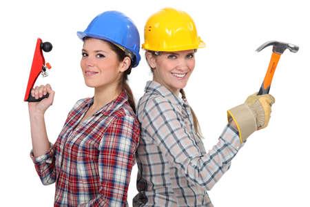 tradeswomen: Tradeswomen holding tools