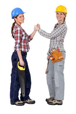 pacto: Las trabajadoras que forman un pacto Foto de archivo