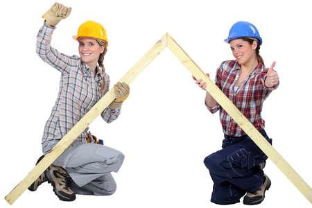 tradeswomen: Female carpenters rejoicing