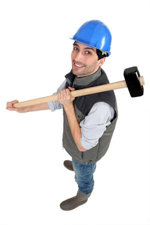 whack: Man posing with sledge hammer