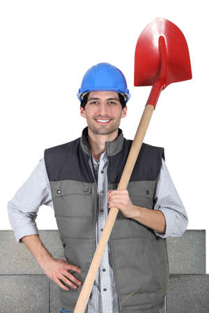 specialization: Mason with shovel Stock Photo