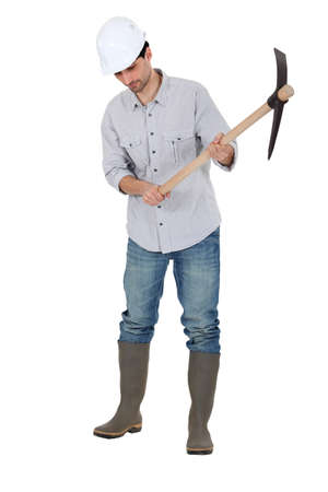 A construction worker with a pickaxe  photo