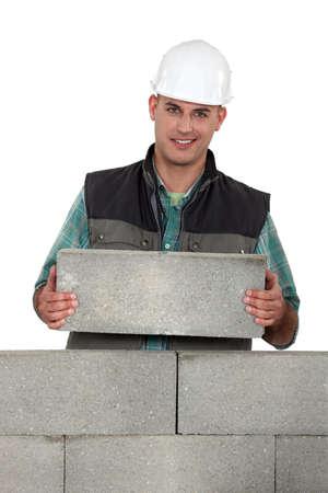 stonemasonry: Tradesman placing a stone