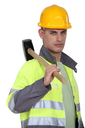 labourer: Labourer carrying a mallet Stock Photo