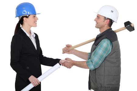 verbal communication: Tradesman shaking an engineer