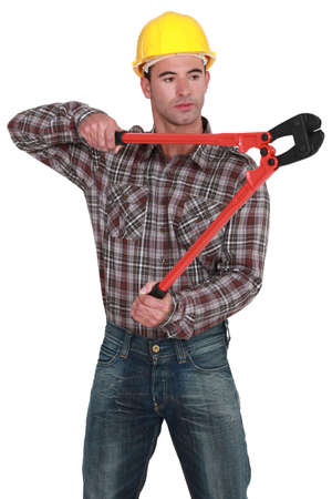 pry: Man using bolt-cutters