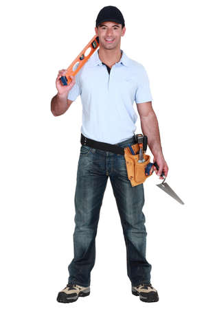portrait of handsome carpenter carrying ruler photo