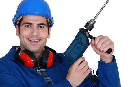 Tradesman holding up an electric screwdriver Stock Photo - 16119662
