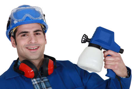 Tradesman holding a spray gun photo