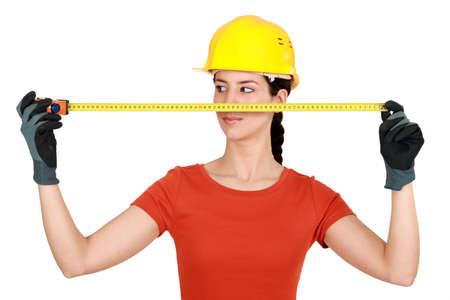 Female builder holding tape measure photo