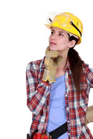 tradeswoman: A pensive tradeswoman