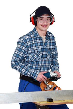 Man using angle grinder photo