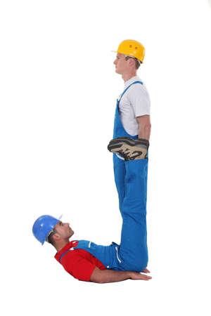 repair man: Two builders forming the letter J