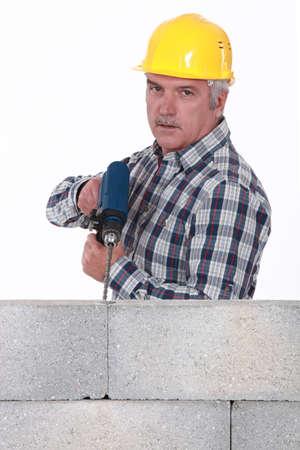 stonemasonry: Tradesman using a power tool