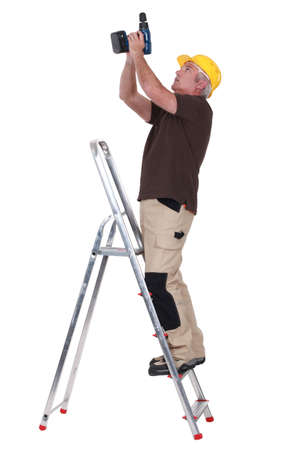 power operated: Man using a screwdriver Stock Photo