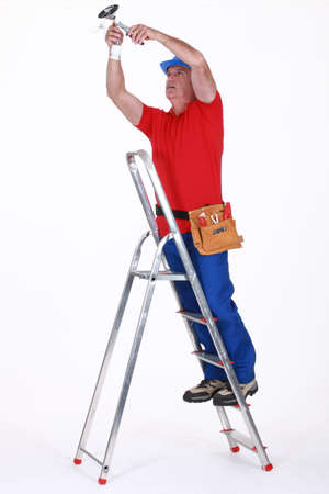 Electrician on a ladder Stock Photo - 16119623