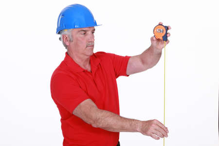 Tradesman using a measuring tape Stock Photo - 16119649