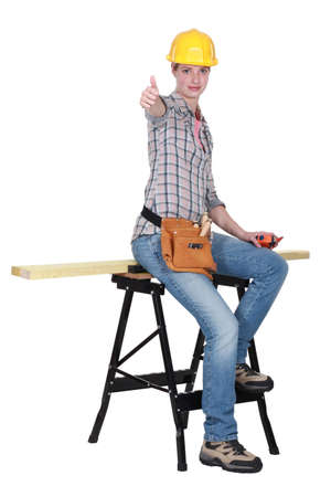 reforming: Thumbs up from a female carpenter