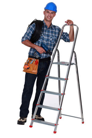 Tradesman standing next to a stepladder Stock Photo - 16119564