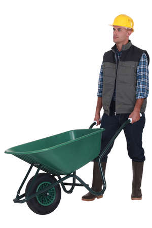 barrow: Man with empty wheelbarrow