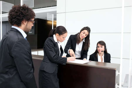 hotel staff: Business reception desk Stock Photo
