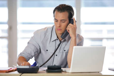 telephone cord: Man working from home Stock Photo