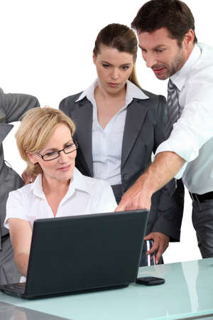 looking around: Business people around laptop