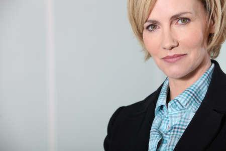 30 to 40: Headshot confident female executive