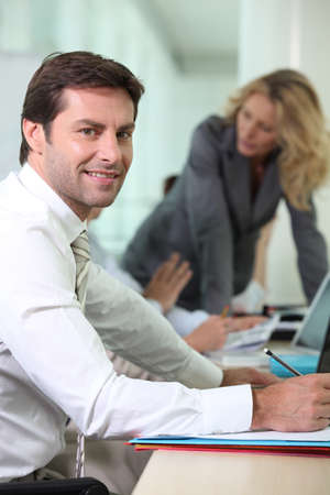 Businessman in an office meeting Stock Photo - 16166963